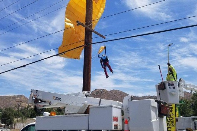 Parachutist suspended from power lines rescued in California